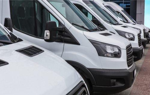 a fleet of clean van vans parked in a row